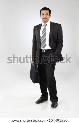 indian Business man with briefcase - stock photo
