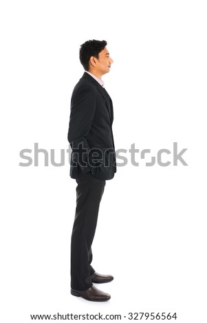 indian business man with coat standing, side view - stock photo