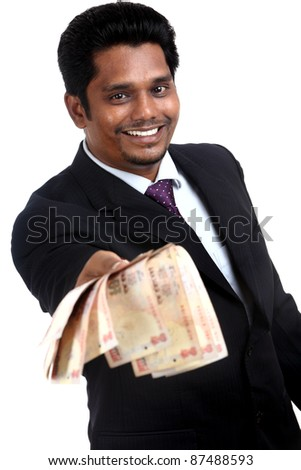 Indian business man with Indian money - stock photo
