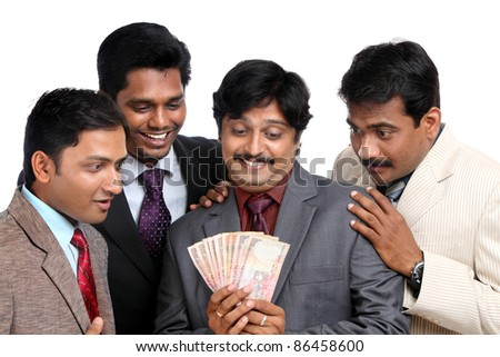 Indian business people posing to the camera.