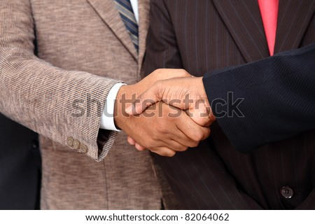 Indian business people shaking hands