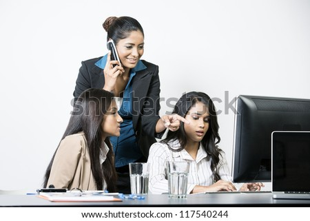 Indian business team working together on a project - stock photo