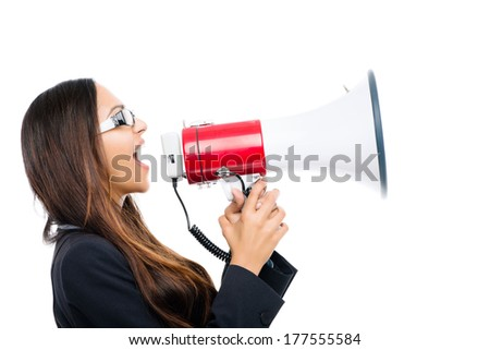 Indian business woman holding megaphone loudspeaker shouting announcement leadership - stock photo
