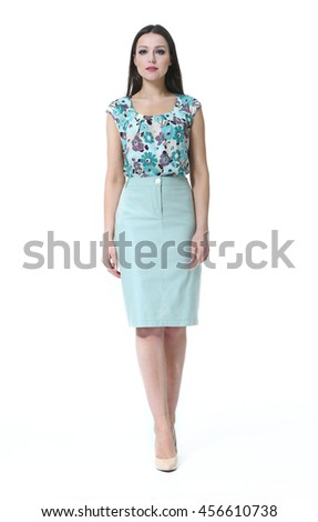 indian business woman with straight hair style in flower print summer print blouse and blue pencil  skirt high heel shoes full body length isolated on white