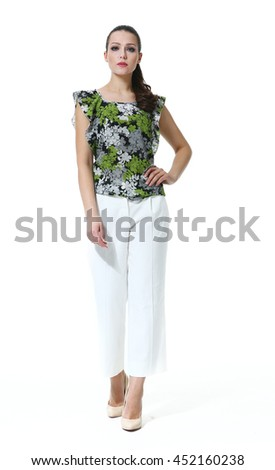 indian business woman with straight hair style in summer print top and white jeans heel shoes full body length isolated on white - stock photo