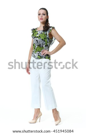 indian business woman with straight hair style in summer print top and white trousers high heel shoes full body length isolated on white - stock photo