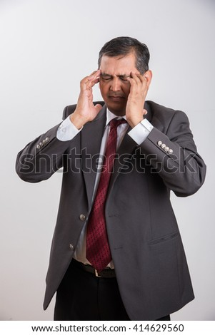 indian businessman and headache, frustrated indian businessman, asian businessman and frustration, isolated over white background