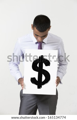 Indian Businessman holding card sign showing Dollar sign.