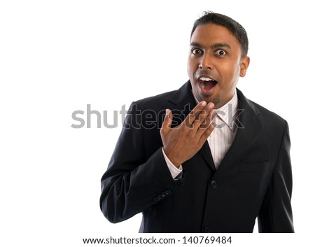 Indian businessman surprise. Good looking Indian man in black suit showing surprising face, isolated on white background. - stock photo