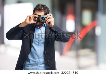 indian businessman taking a picture