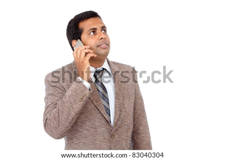 Indian businessman talking in mobile phone. - stock photo