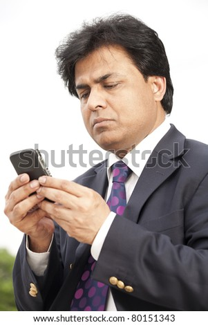 Indian businessman using cell phone