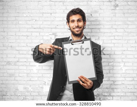 indian businessman with an inventory - stock photo