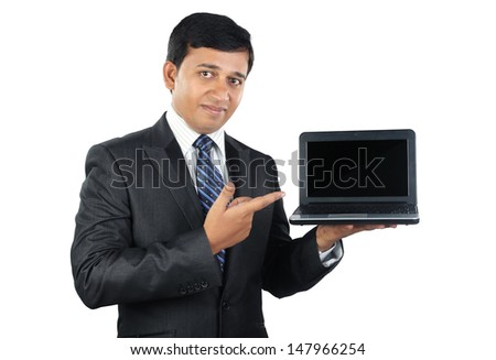 Indian Businessman with Laptop - stock photo