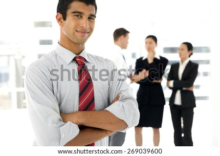 Indian businessman with partners in the background - stock photo