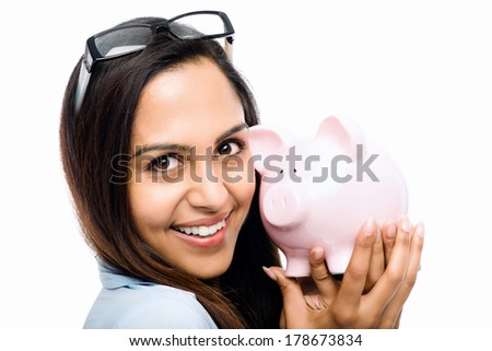 Indian businesswoman holding piggy bank on white background - stock photo