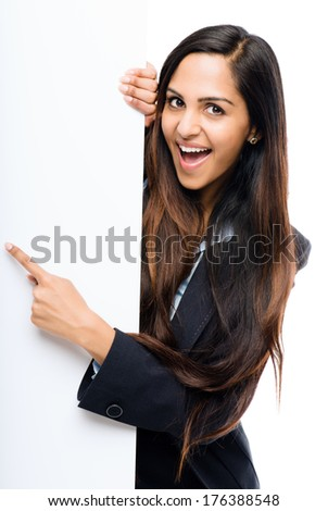 Indian businesswoman holding white placard copy space white background - stock photo