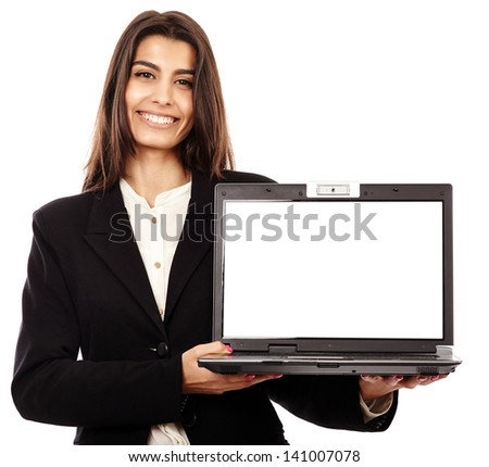 Indian businesswoman presenting a laptop with copyspace on the monitor - stock photo