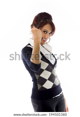 Indian businesswoman punches fist into the air isolated on white background - stock photo