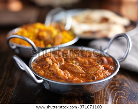 indian butter chicken curry in balti dish - stock photo