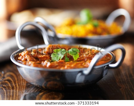 indian butter chicken curry in balti dish shot with selective focus - stock photo