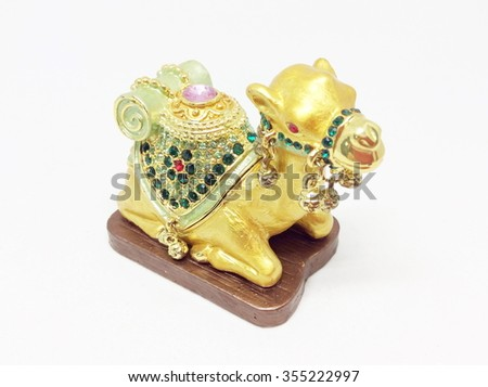 Indian Camel toy on white background. A souvenir.