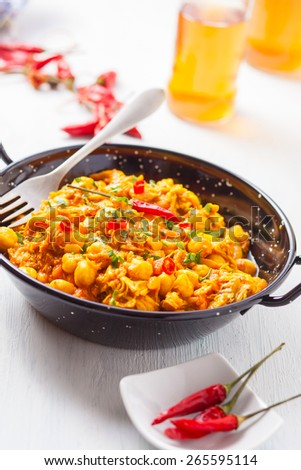 indian Chana masala with peas and chili pepper on pan - stock photo