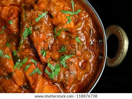 Indian chicken jalfrezi curry food in balti dish - stock photo