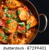 Indian chicken jalfrezi curry in balti dish - stock photo