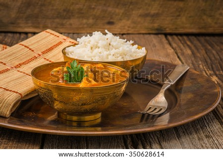 Indian chicken madras served with white basmati rice. - stock photo