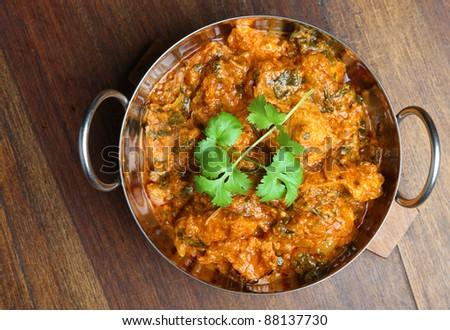 Indian chicken saag massala curry in balti dish. - stock photo
