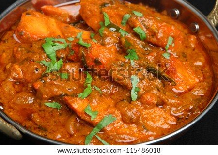 Indian chicken tikka jalfrezi curry in balti dish. - stock photo