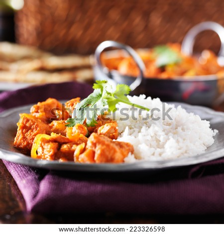 indian chicken vindaloo curry with basmati rice - stock photo