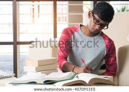 indian college student doing homework - stock photo
