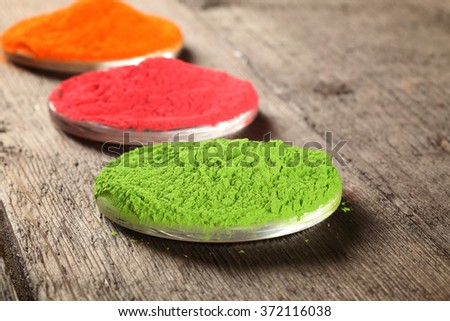 Indian color festival called Holi on wood background - stock photo