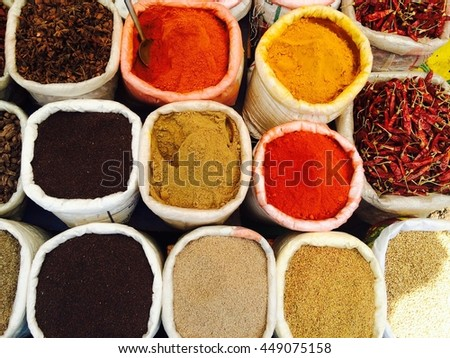 Indian colored spices at Anjuna flea market in Goa, India - stock photo