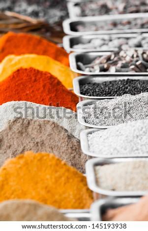 Indian colorful spices and tea at Anjuna flea market in Goa, India - stock photo