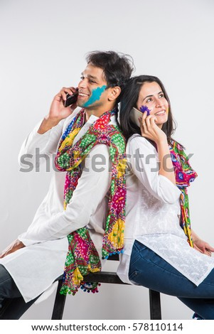 stock photo indian married couple holi festival chatting phone