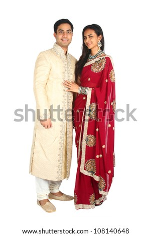 Indian couple in traditional wear. Isolated on a white background. - stock photo