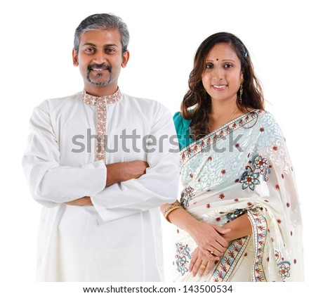 Indian couple. Portrait of mid age beautiful Indian family in traditional costume standing isolated on white background. Indian husband and wife model.