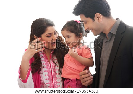 Indian couple with their two year old daughter - stock photo