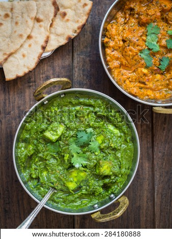 indian cuisine palak paneer and paneer tikka masala in traditional copper bowls with ornamented handles - Buffet Retro Cuisine