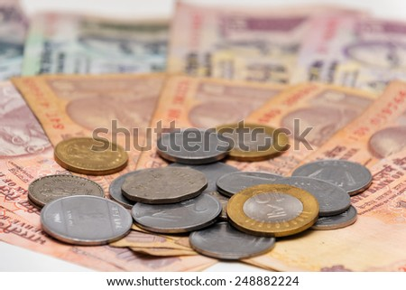 Indian Currency different Rupee bank notes and coins background - stock photo