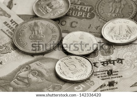 Indian currency notes and coins - stock photo