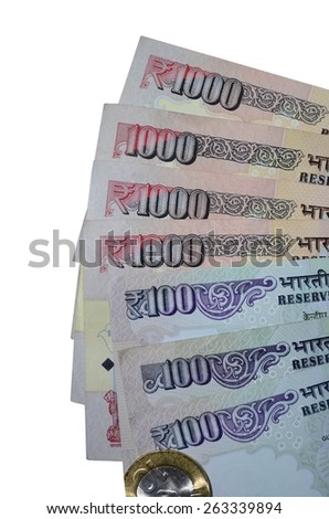 Indian currency notes of denomination 100 and 1000 with rupee coin of value 10 - stock photo