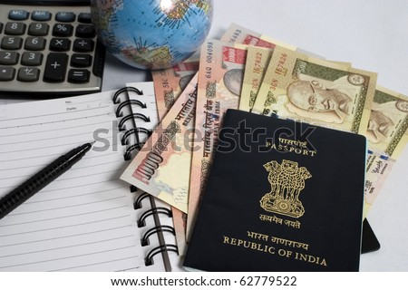 indian currency with passport and calculator, concept for making travel budget - stock photo