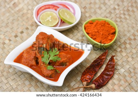 Indian curry food hot spicy red Kerala chicken curry with thick gravy. Indian chicken roast. Top view - stock photo