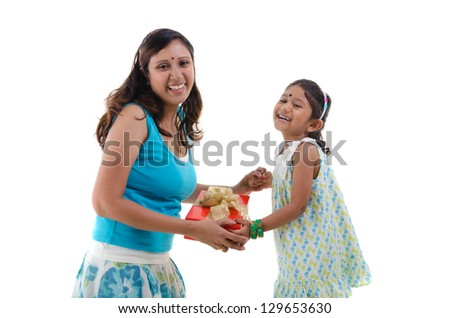 indian daugther and mother with present during celebration - stock photo