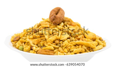 Indian Delicious And Crunchy Mix Namkeen Food Also Know As Mixture, Chivda, Farsan, Namkin, Nimco or Nimko Made of Gram Flour And Mixed With Dry Fruits isolated on White Background