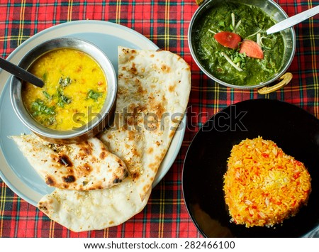 Indian dishes. Rice, dal, Palak paneer, chapatti - stock photo